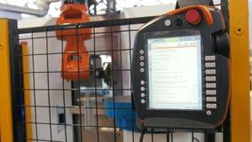 LCD遥控为机器人手机械工具在工业制造工厂 影视素材