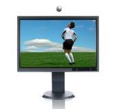 Lcd-Überwachungsgerät und Fußball-Spieler Stockfoto