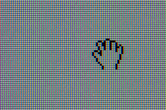 LCD computer monitor with hand cursor. Close-up shot of matte LCD computer monitor with hand cursor royalty free stock image