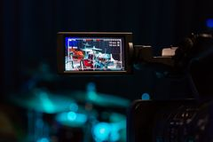 The LCD display on the camcorder. Filming the concert. Drum set and bass.  Stock Image