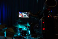The LCD display on the camcorder. Filming the concert. Drum set and bass.  royalty free stock photo