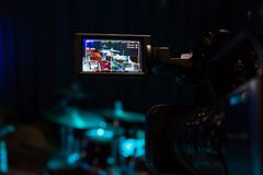 The LCD display on the camcorder. Filming the concert. Drum set and bass.  Royalty Free Stock Images