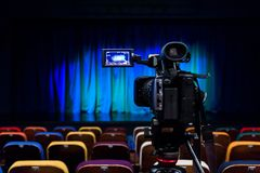 The LCD display on the camcorder. Shooting theatrical performances. The TV camera. Colorful chairs in the auditorium.  Stock Photography