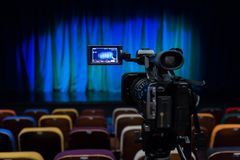 The LCD display on the camcorder. Shooting theatrical performances. The TV camera. Colorful chairs in the auditorium.  Royalty Free Stock Photography