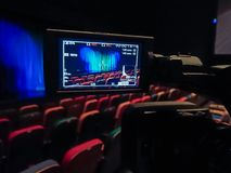 The LCD display on the camcorder. Videography in the theater. Blue-green curtain on the stage.  royalty free stock photography