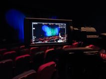 The LCD display on the camcorder. Videography in the theater. Blue-green curtain on the stage.  royalty free stock image
