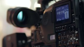 LCD display screen on a High Definition TV camera. With timecode in a studio HD stock video