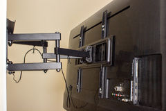 LCD display on the TV bracket. Swivel bracket for TV Royalty Free Stock Photography