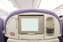 LCD het scherm in vliegtuigzetel Stock Foto's