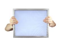 Lcd monitor. Two hands holding lcd monitor Royalty Free Stock Images