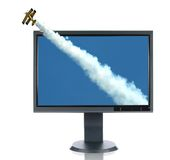 LCD Monitor and Airplane. Isolated over a white background Royalty Free Stock Photography