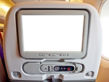 LCD monitor at airplane seat Stock Photo