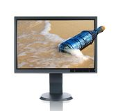 LCD Monitor and Bottle. LCD monitor and message in a vintage bottle isolated over a white background Stock Image