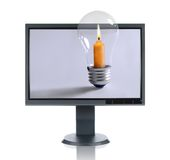 LCD Monitor and Candle Stock Photos