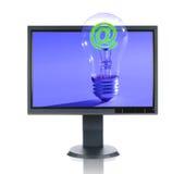 LCD Monitor en Gloeilamp Stock Foto's