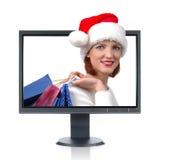 LCD Monitor en Kerstman Stock Fotografie
