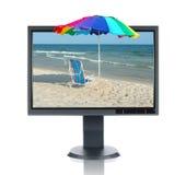 LCD Monitor en Strand Stock Foto
