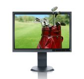 LCD Monitor and Golf. Bag isolated over a white background Royalty Free Stock Photos