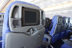 LCD monitor on Seat of airplane. LCD monitor on Passenger Seat of airplane with empty copy space Stock Image