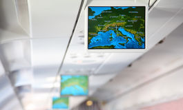Lcd monitor showing a map of Europe. Inside salon of aircraft Royalty Free Stock Photos