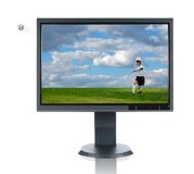 LCD Monitor and Soccer. Player kicking ball isolated over a white background Stock Photo
