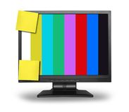 LCD monitor test pattern. LCD monitor with colorful test pattern displayed and two blank, yellow sticky notes Stock Image