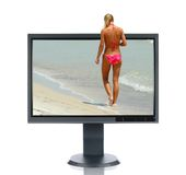 LCD Monitor and Woman. Walking on the beach isolated over a white background Stock Images