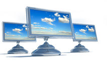 Lcd monitors. Flat panel lcd computer monitors on white background - 3d render royalty free illustration