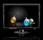 LCD panel with christmas balls Royalty Free Stock Photo