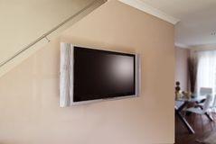 LCD or plasma tv. Wall mounted LCD or Plasma flatscreen Television in home lounge royalty free stock photo