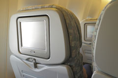 LCD screen in airplane seat Stock Image