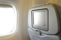 LCD screen in airplane seat Royalty Free Stock Photos