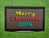 Lcd screen. On artificial green grass of merry christmas 2014 Stock Images