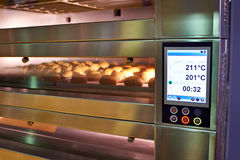 LCD screen of oven with bread in bakery. LCD screen of oven with bread in the bakery Royalty Free Stock Photography