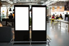 LCD screens for advertising in a restaurant. White screen, you can insert your picture here royalty free stock photo