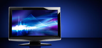 LCD Television Set. On reflective table royalty free stock image