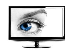 Lcd TV. Modern HD TV showing a beautiful female blue eye