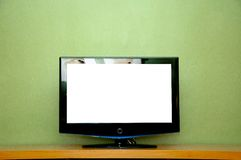 LCD TV. On wooden table Royalty Free Stock Photos