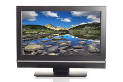 LCD TV. Displaying a beautiful landscape picture Royalty Free Stock Photo