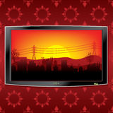 Lcd tv background. LCD TV with sunset city background Royalty Free Stock Image
