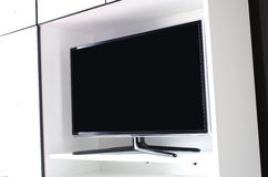 LCD tv. Flat panel television embedded in white modern furniture Stock Photos