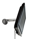 LCD TV/monitor mounted on a wall Royalty Free Stock Photo