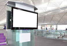 Lcd-TV på flygplatsen Royaltyfria Bilder
