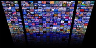 LCD TV panels as Video wall with colorful images stock photos