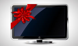 LCD TV with red bow Royalty Free Stock Photography