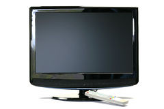 LCD TV with remote control Royalty Free Stock Photography