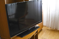 LCD TV in the room. Big LCD TV screen in the room against natural light in the background royalty free stock photo