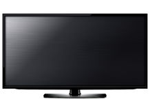 LCD tv screen. Black LCD tv screen hanging on a wall .  (with clipping work path Stock Image