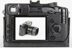 LCD view of well used, retro style digital camera Stock Images