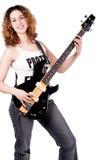 Lächeln, Aufstellung und Spielen mit meiner Gitarre Lizenzfreie Stockfotografie